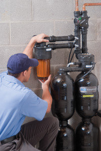 Service Technician Inspecting a Water Softener